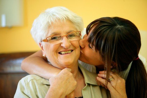 woman_kissing_elderly_mother_compassion_50